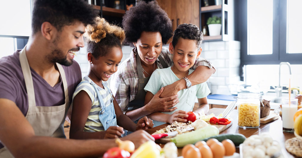 Happy family together preparing healthy food in the kitchen; blog: 6 Healthy Eating Habits for Kids